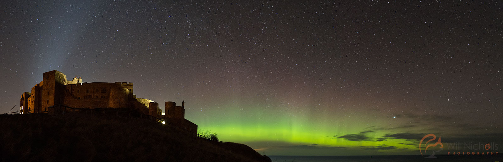 The Northern Lights at Bamburgh Castle, Northumberland.
