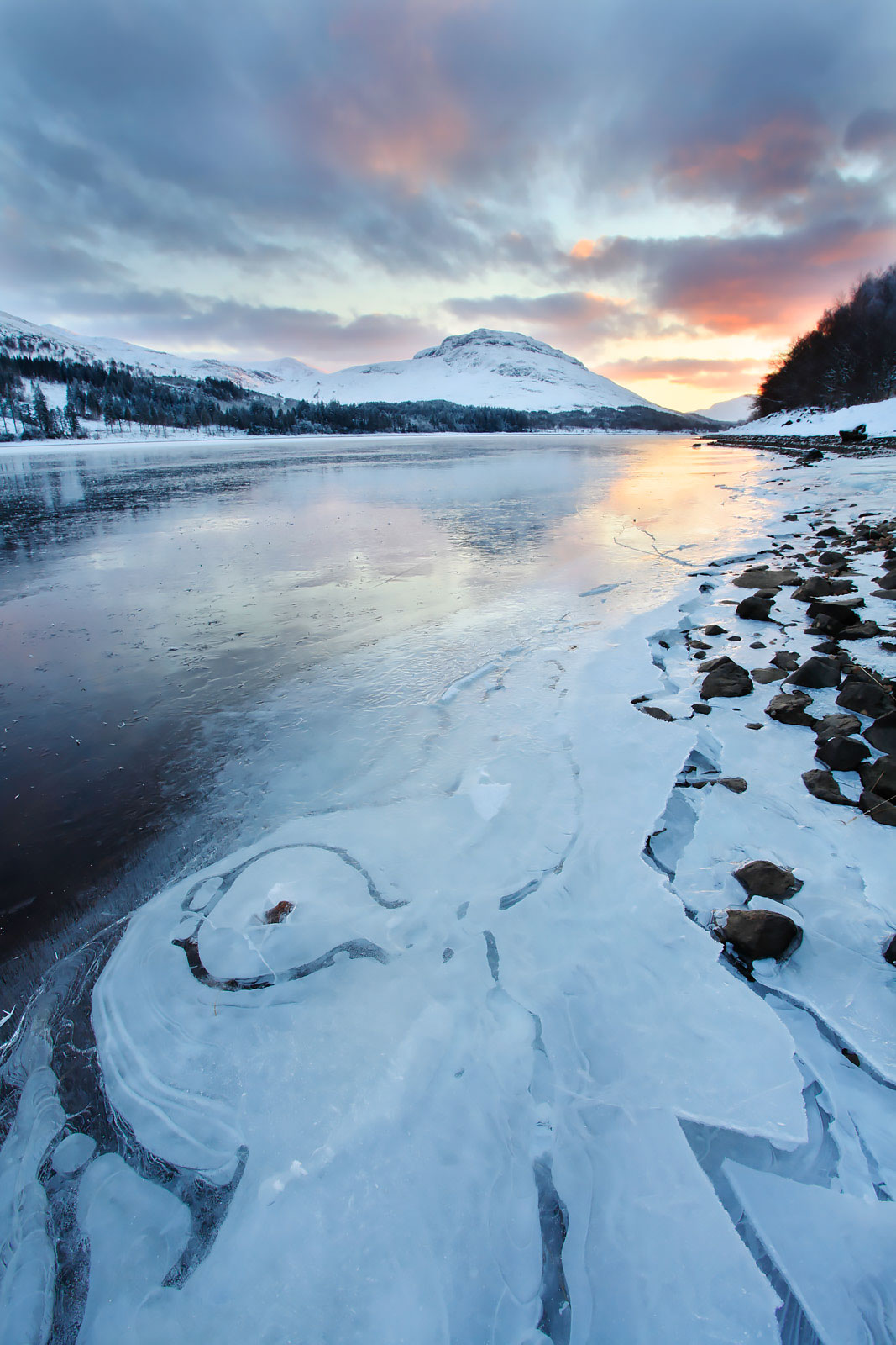 Loch Laggan, ice paterns and sunset. Inverness-shire, Scotland, December 2010.