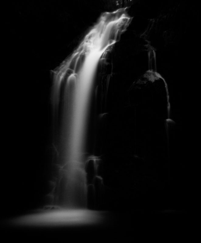 Black and white photo of a waterfall