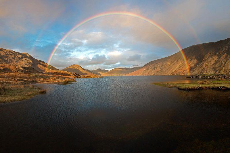 Full rainbow over lake