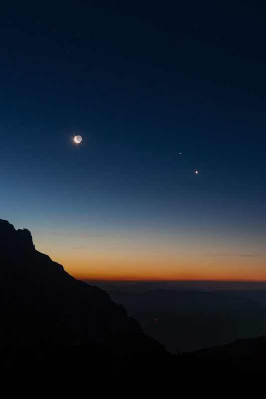 A nice planetary grouping (Moon-Venus-Mars) above Caraiman Valley, in the Bucegi Mountains, Romania.