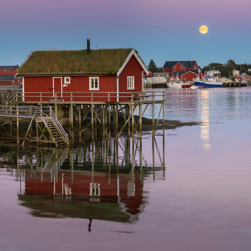 Moon rising above traditional fishermen's houses