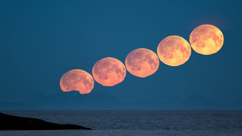 A sequence of a distorted Full Moon rising above Vestfjord in Northern Norway