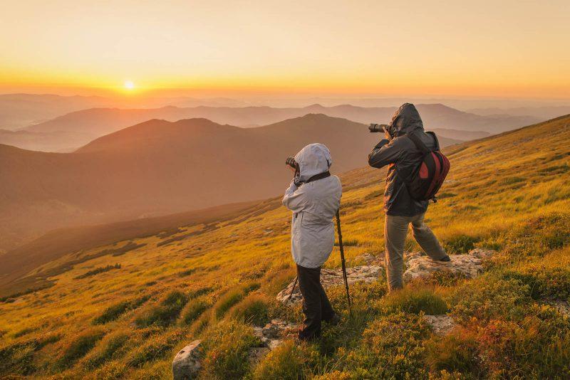 landscape photographers at sunset