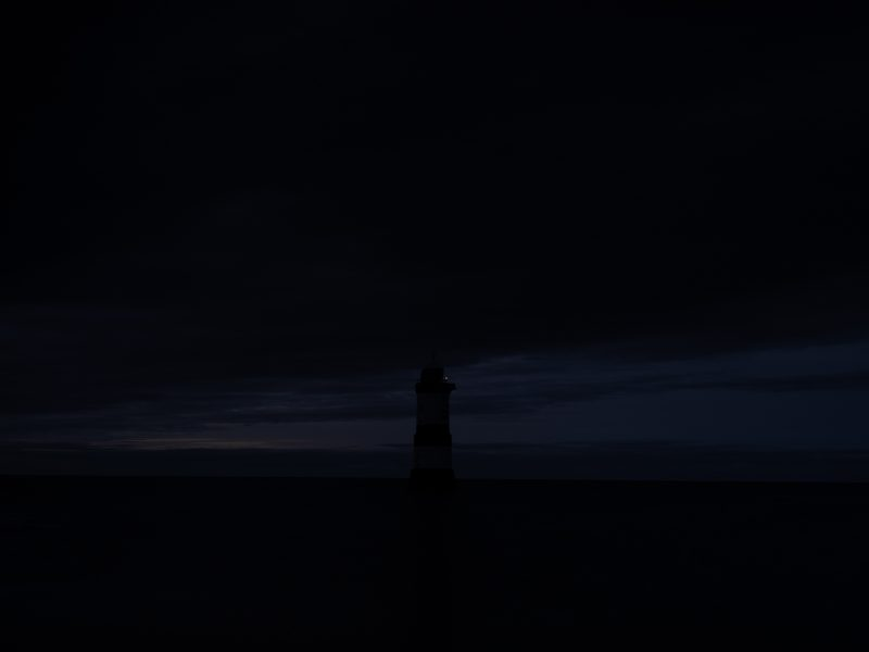 Underexposed lighthouse photographed on Fuji GFX100