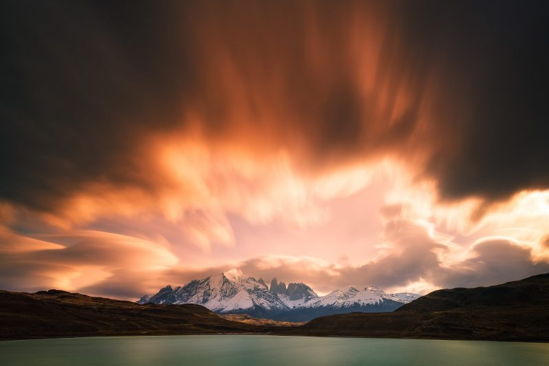 ambient sunlight shining over mountains and lake
