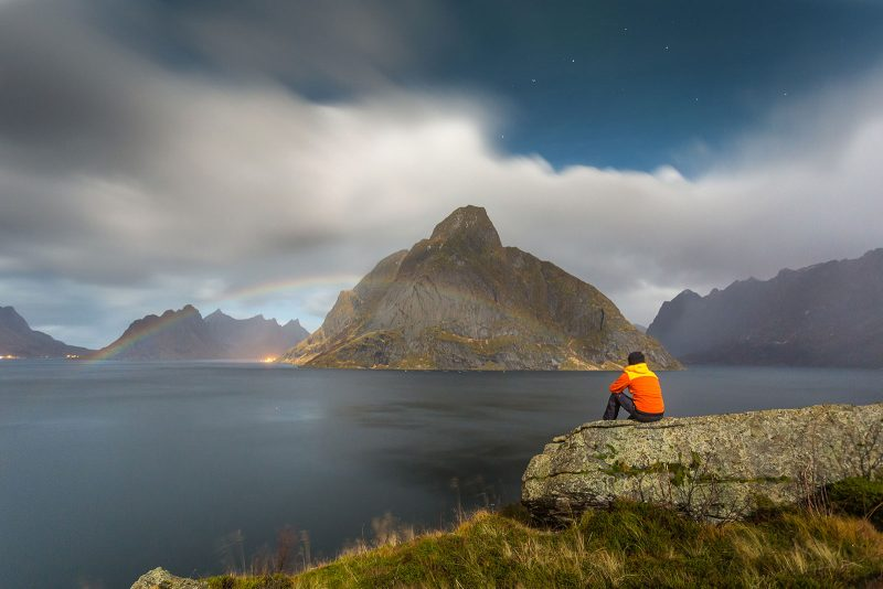 bright moonbow photographed in the Lofoten Islands, Northern Norway. Mount Olstind is in the background