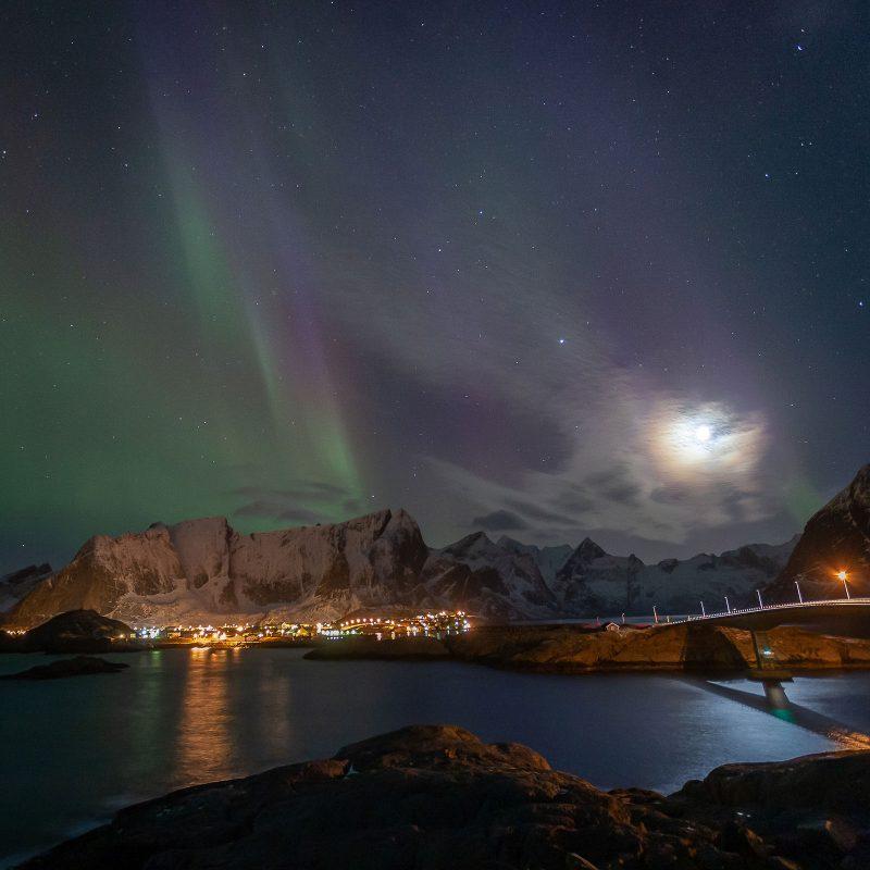 the northern lights and a moon corona