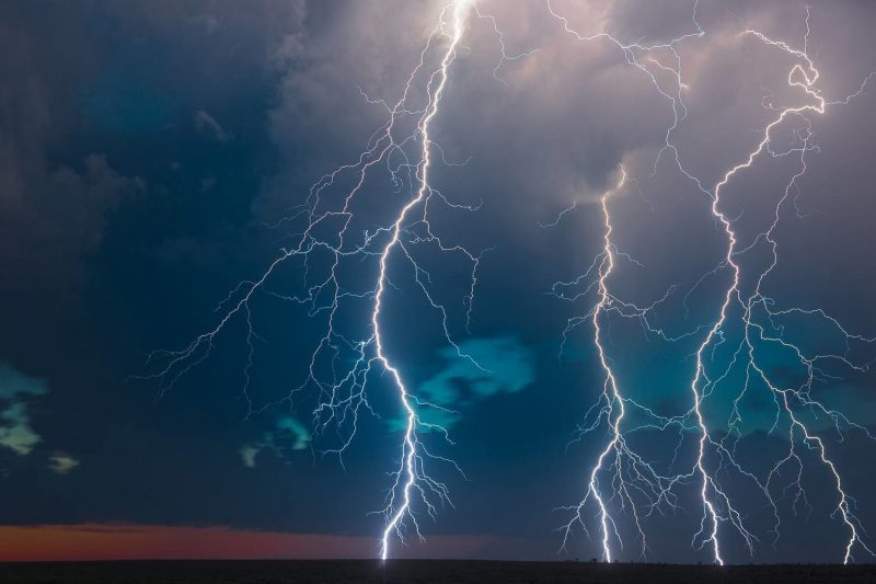 three lightning strikes in a stormy sky