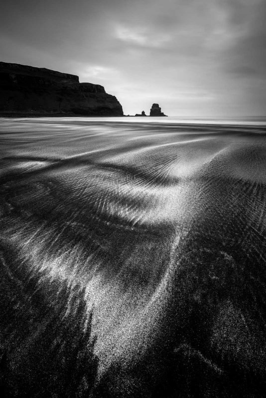 black and white landscape photo with sand details