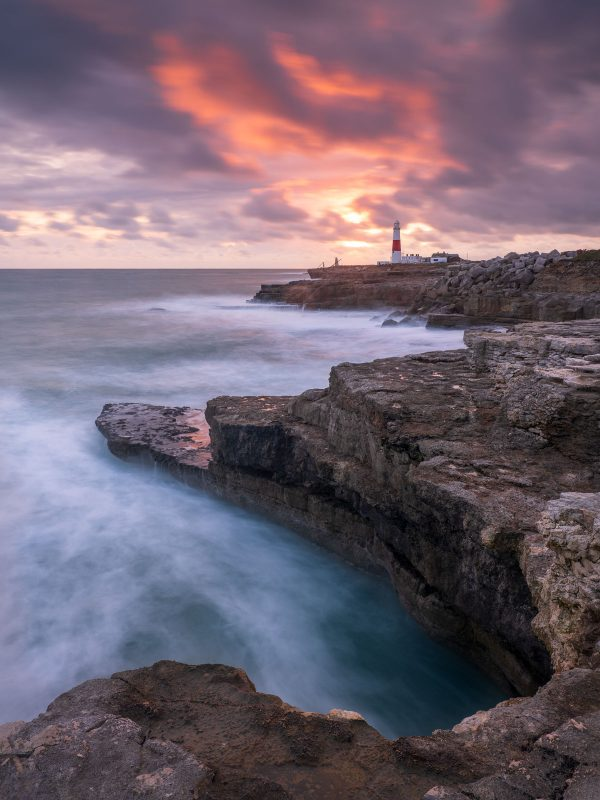 Sunset over Portland Bill lighthouse.
