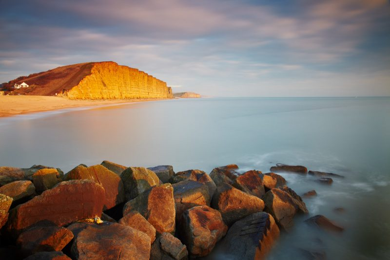 Golden evening light on West Bay's east cliff