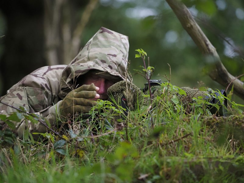wildlife photographer in full camouflage