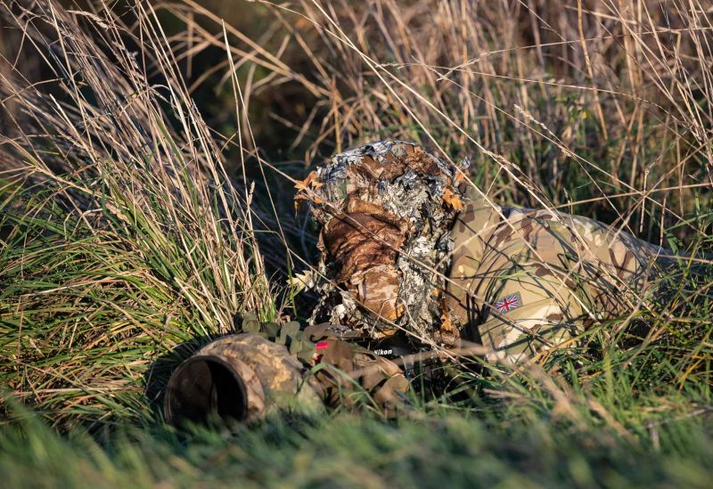 wildlife photographer in full camouflage