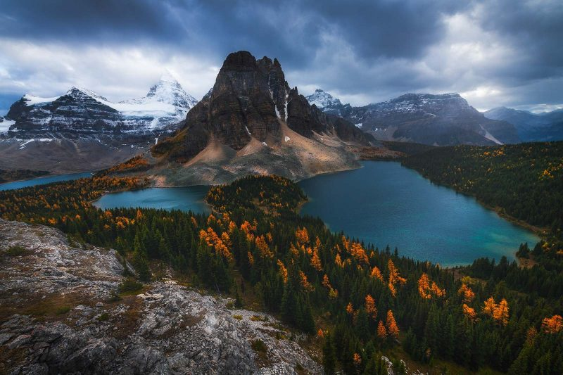 A dramatic sky over mountains, lakes and forests
