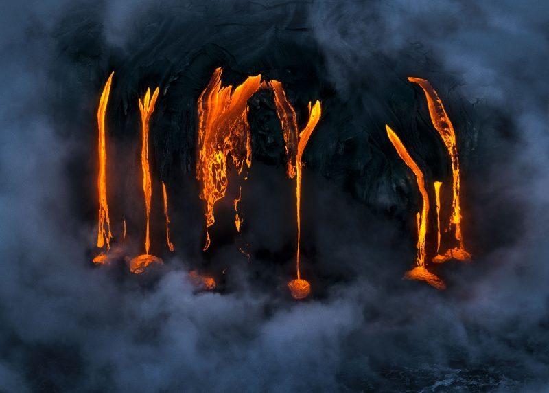 Lava drips down rock
