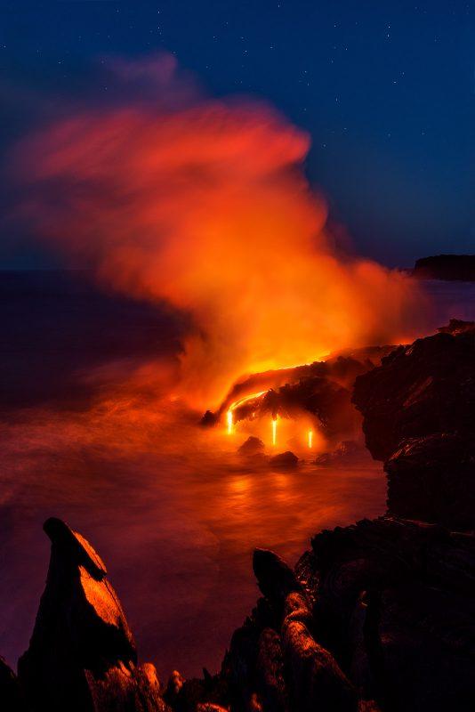 Lava meets the sea at night