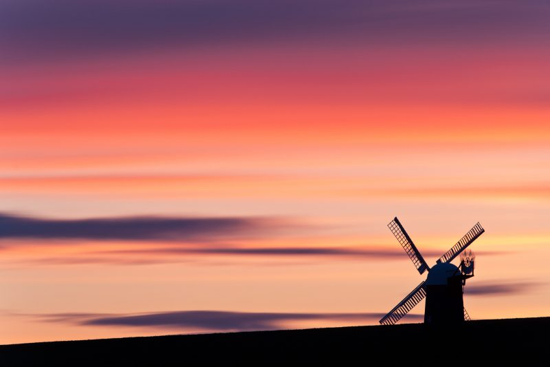 Wilton Windmill silhouetted against colourful sunset