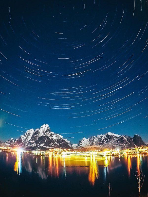 Star trails above the village of Reine in Lofoten