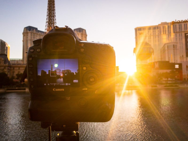 Camera photographing timelapse at sunset