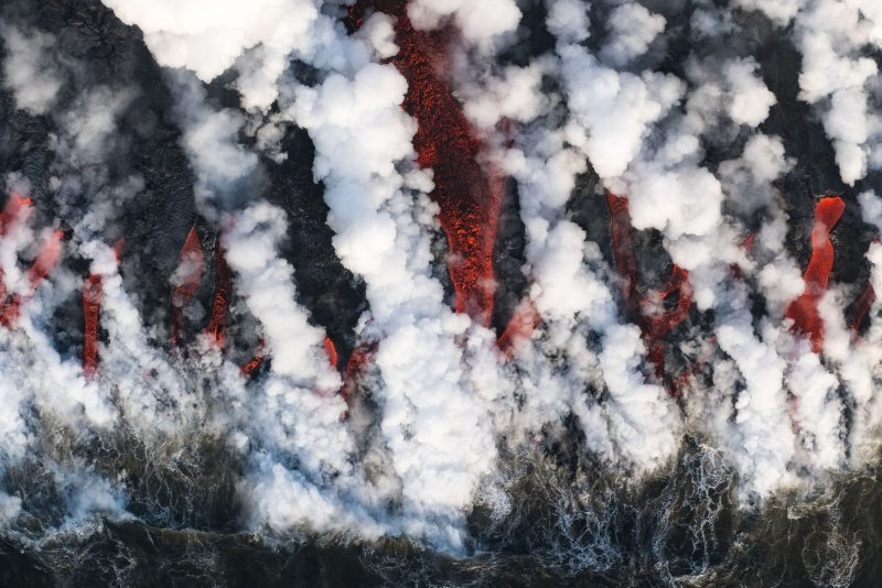 Helicopter shot of lava entering the sea