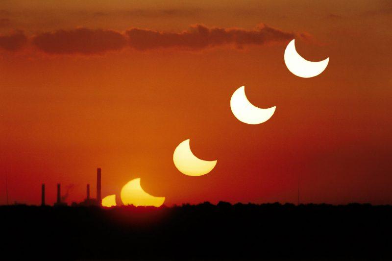 A partial solar eclipse at sunrise