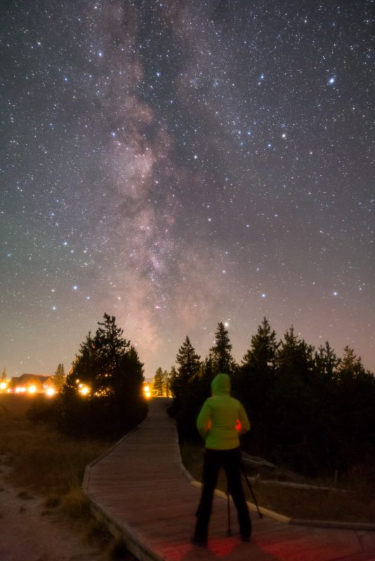 Astrophotographer under the Milky Way in yellowstone national park