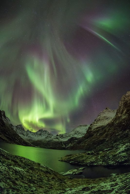 Active Northern Lights above the mountains in the Lofoten Islands