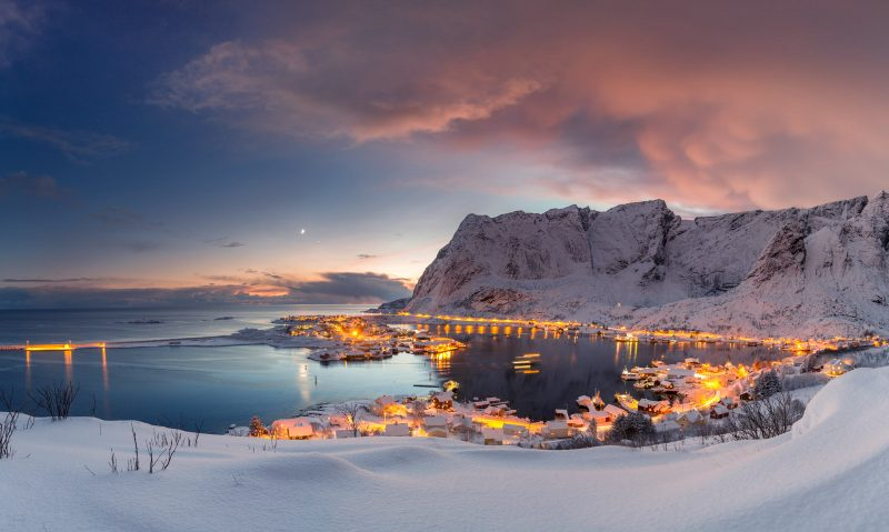 The Moon is in conjunction with Jupiter above the picturesque village of Reine