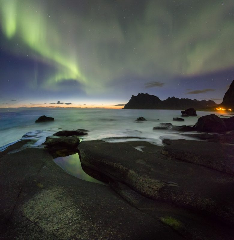 Northern Lights above the intriguing rocks on the beach at Uttakleiv.